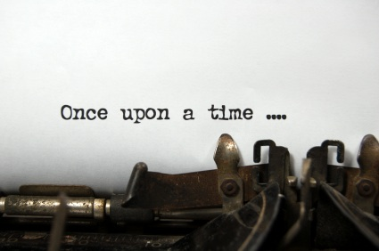 typewriter with page that says once upon a time
