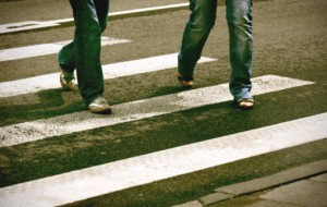 pedestrians in crosswalk can only see jeans and sneakers