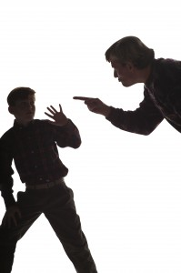 silouette of father yelling at son