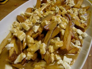 plate of poutine, canadian fries with gravy and cheese curds