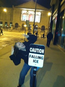 donna talarico with caution falling ice sign pretending it is falling on her from above