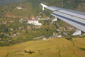 plane over buthan with village below