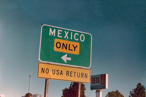 """a highway sign on border that says """"mexico only - no usa return"""""""
