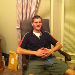 rob hanson sitting in chair