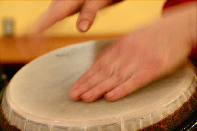 close up of man's hands on a drum