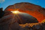 sunrise at canyonlands park through mesa arch