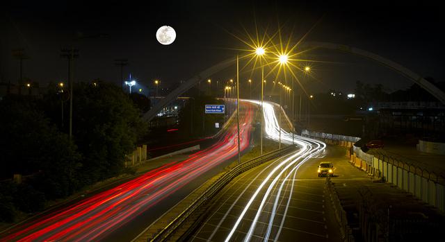 highway in dehli at nights - tailights glowing
