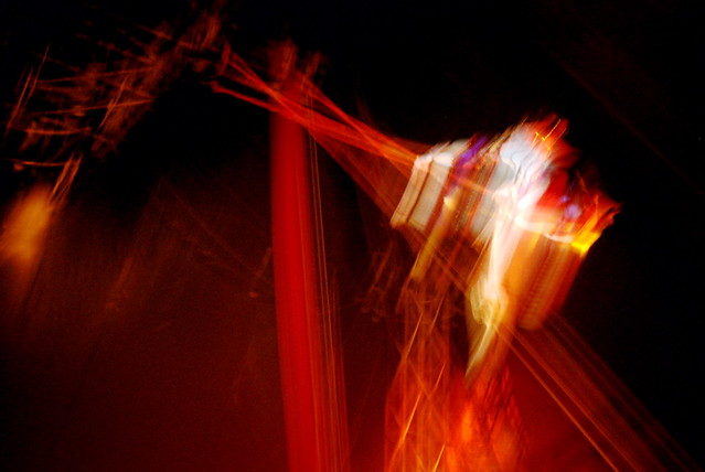 blurry image (to show motion) of a trapeze artist